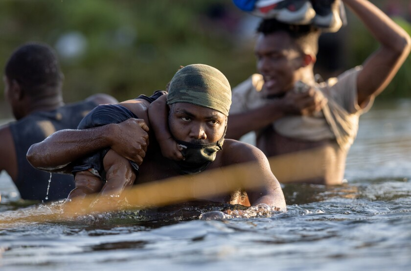 Haitian immigrants cross the Rio Grande back into Mexico from Del Rio, Texas on September 20, 2021 to Ciudad Acuna, Mexico.