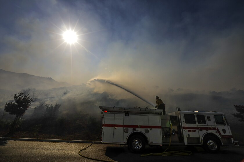 Riverside brush fire grows to 100 acres and threatens structures