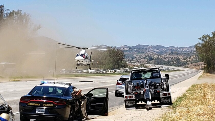 Traffic was shut down on northbound Interstate 15 north of state Route 76 to allow a helicopter to land Sunday afternoon to pick up a patient. A passenger was injured when a car went off the freeway and hit a tree, killing the driver.