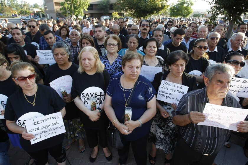 The Iraqi Chaldean community of El Cajon took part in a prayer vigil last Friday at the El Cajon Civic Center's Centennial Plaza for the Christians in Iraq that have been persecuted and chased out of Northern Iraq.