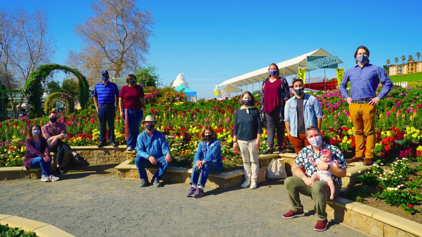 Carlsbad's New Village Arts staff photographed at The Flower Fields at Carlsbad Ranch.