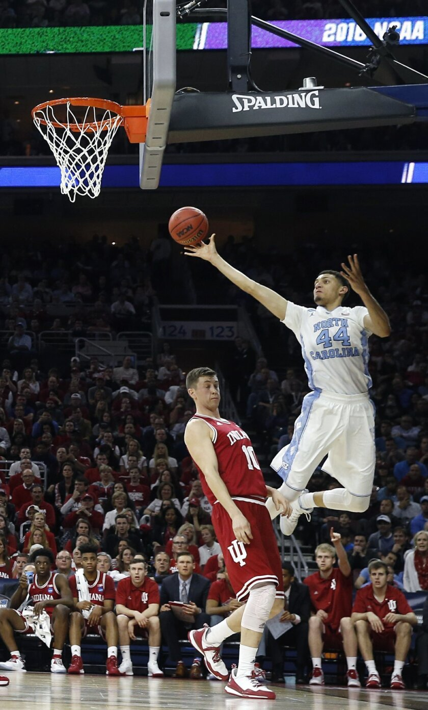 North Carolina's Justin Jackson shoots as Indiana's Ryan Burton defends during the first half of an NCAA college basketball game in the regional semifinals of the men's NCAA Tournament, Friday, March 25, 2016, in Philadelphia. (AP Photo/Matt Rourke)