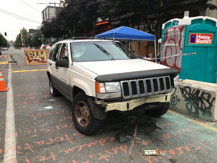 Shots were fired into a white SUV in Seattle's protest zone early Monday, according to 911 callers.
