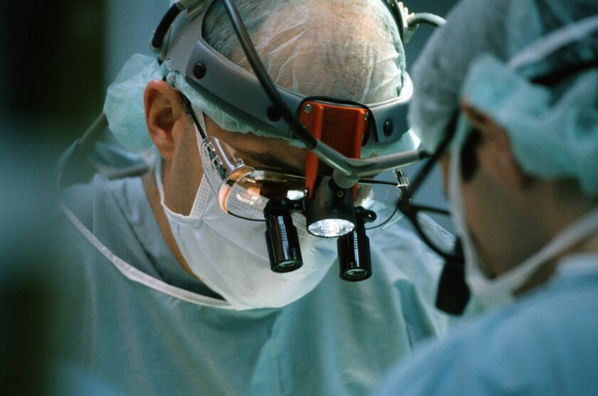 Doctor performing open heart surgery.