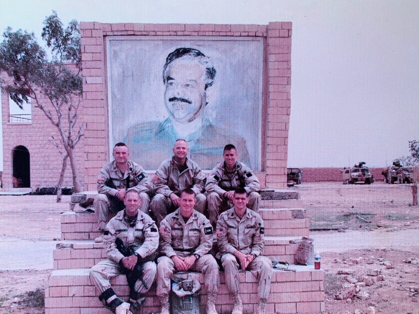 Charles Hartford (top center) poses with members of the Joint Special Operations Task Force that raided Saddam Hospital in Iraq.