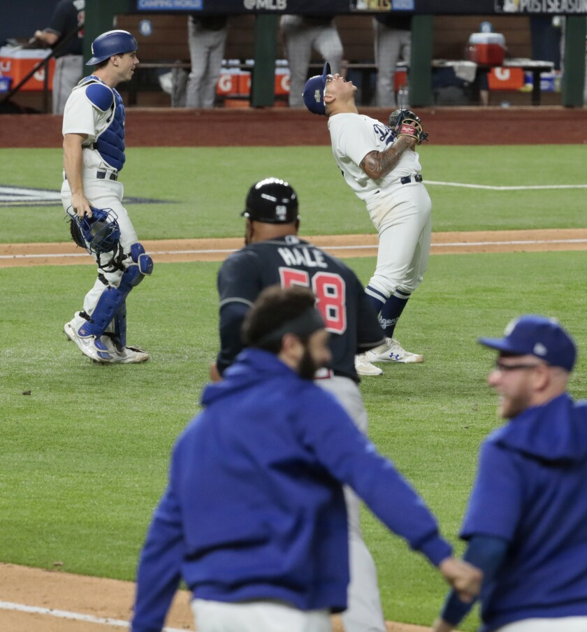Julio Urías celebrates after the final out of the Dodgers' 4-3 win against the Atlanta Braves.