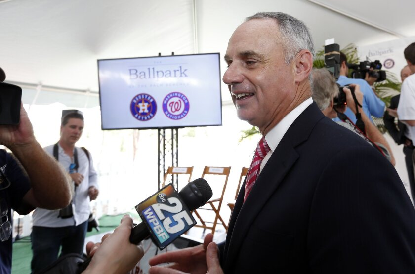 Major League Baseball Commissioner Rob Manfred speaks with reporters Monday in West Palm Beach, Fla.
