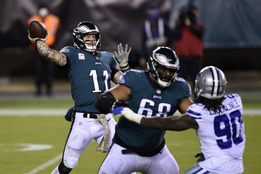 Philadelphia Eagles' Carson Wentz passes during the second half of an NFL football game against the Dallas Cowboys, Sunday, Nov. 1, 2020, in Philadelphia. (AP Photo/Derik Hamilton)