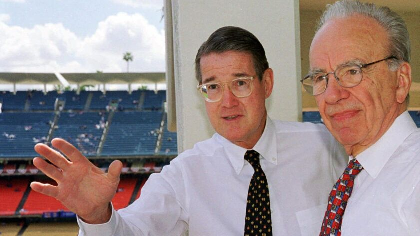 Former Dodgers owner Peter O'Malley, left, and new owner Rupert Murdoch look over the playing field during Opening Day in Los Angeles on April 7, 1998.