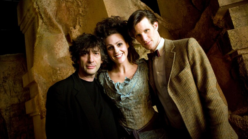 """Neil Gaiman, left, on the set of """"Dr. Who"""" for an episode he wrote."""