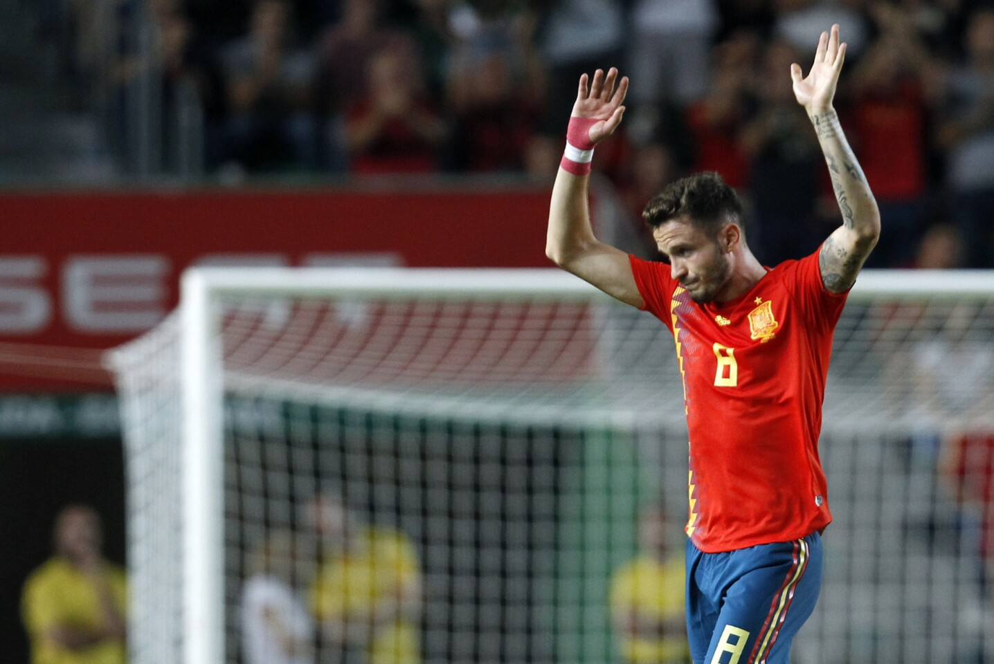Spain's Saul Niguez greets supporters and leaves the field during the UEFA Nations League soccer match between Spain and Croatia at the Manuel Martinez Valero stadium in Elche, Spain, Tuesday Sept. 11, 2018. (AP Photo/Alberto Saiz)