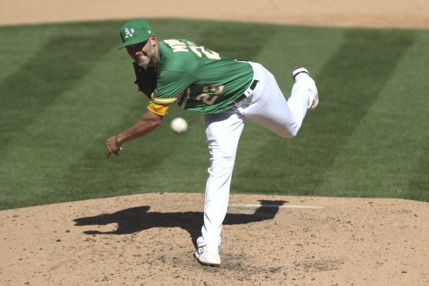 Oakland Athletics' Mike Minor pitches against the Seattle Mariners' during the fifth inning of the first baseball game of a doubleheader in Oakland, Calif., Saturday, Sept. 26, 2020. (AP Photo/Jed Jacobsohn)