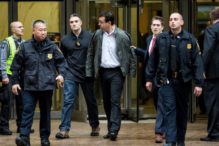 """Attorney Evan Greebel, center, is brought out of 26 Federal Plaza by law enforcement officials after being arrested Dec. 17, 2015, in New York. He was sentenced Friday to 18 months behind bars for aiding """"Pharma Bro"""" Martin Shkreli in an $11-million fraud."""
