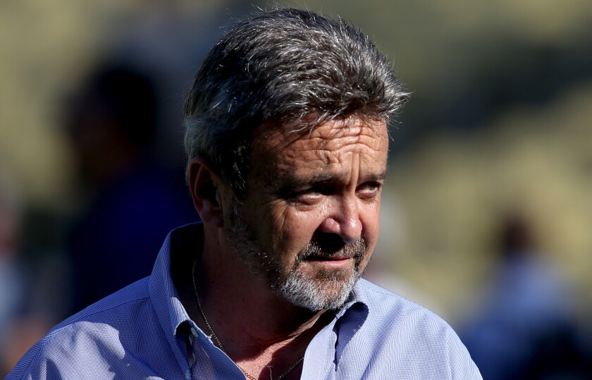 General Manager Ned Colletti is said to be on the hot seat after the Dodgers' exit from the playoffs.