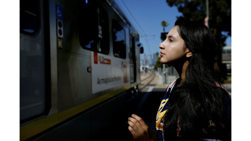 Yecenia Perez, a 17-year-old senior at Orthopaedic Hospital Medical Magnet High School, walks to the train after class. She dreams of going to college: either UC Berkeley or Stanford.