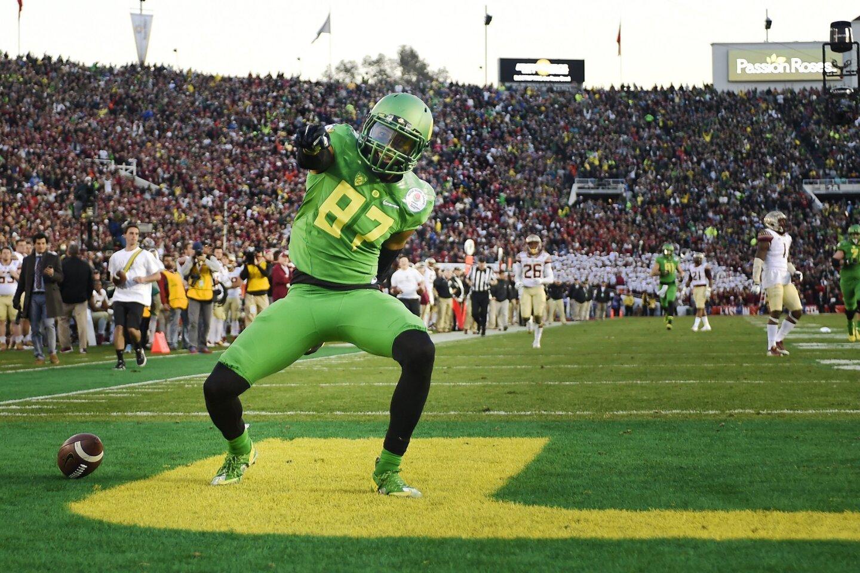 Oregon's Darren Carrington celebrates a 3rd quarter 51-yard touchdown against Florida St. in the Rose Bowl.