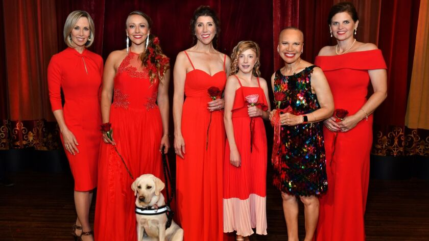 Barbara-Lee Edwards (emcee); heart disease survivors Emily Harper-Guerra (with Bailey), Melissa Mitc