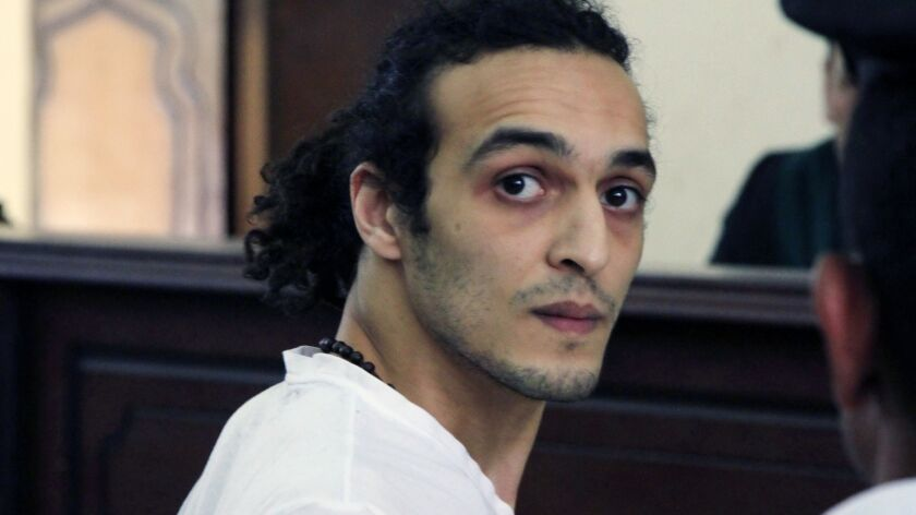 Egyptian photojournalist Mahmoud Abou Zeid, known by his nickname Shawkan, appears before a judge in 2015 after spending more than 600 days in prison in Cairo, Egypt.