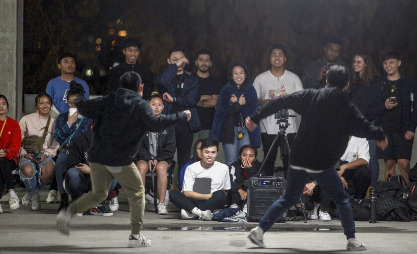 Cole Dungca, 19, left, and his brother Aldrin Dungca, 18, perform their hip-hop dance for fellow dancers during the end of the year choreography project put on by the SDSU Vietnamese Student Organization Modern, a collegiate hip-hop dance troupe, in a parking garage on the SDSU campus on Thursday, Dec. 5, 2019.