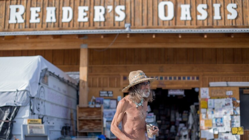 The naked bookseller at the Reader's Oasis in Quartzsite, Ariz.