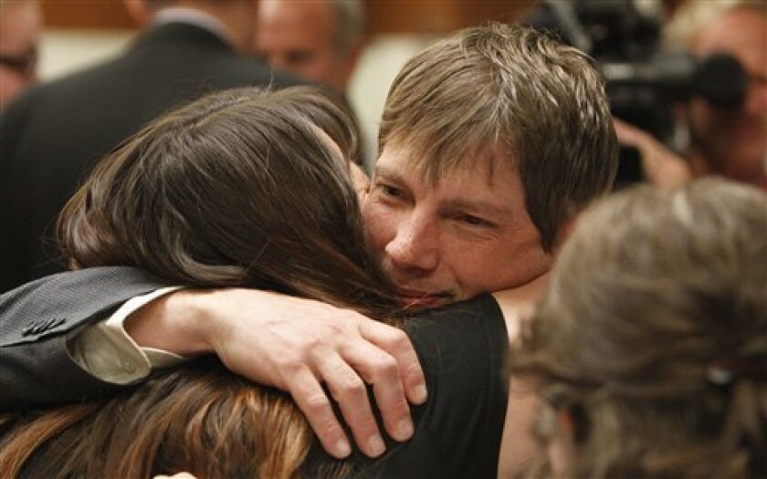 Plaintiff Kerry Lewis hugs his girl friend Rechel Devoss following court Friday, April 23, 2010, in Portland, Ore. A jury on Friday ordered the Boy Scouts of America to pay $18.5 million to Lewis who was sexually abused by a former assistant Scoutmaster in what is believed to be the largest such aw