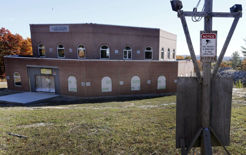 In this Friday Oct. 30, 2015, photo, the state's first mosque is seen in Manchester, N.H. Muslim leaders trying to build the mosque face many of the same struggles other houses of worship contend with: Lack of funds and shrinking attendance. (AP Photo/Jim Cole)