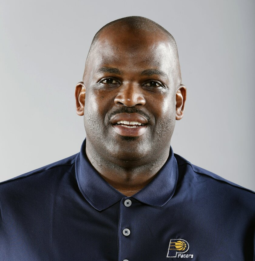 FILE - This is a Sept. 28, 2015, file photo shows Indiana Pacers NBA basketball assistant coach Nate McMillan posed during the team's media day in Indianapolis. On Monday, May 16, 2016, Pacers team president Larry Bird promoted the 51-year-old McMillan to head coach in hopes that he could change th