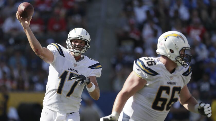 Chargers quarterback Philip Rivers launches a pass while being protected by offensive lineman Dan Feeney against the Chiefs.
