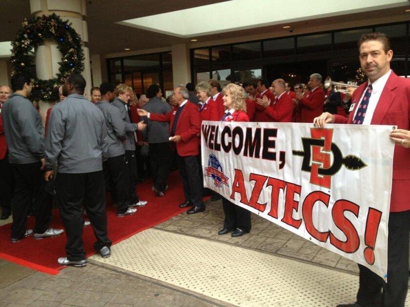 The San Diego State Aztecs check into the Sheraton on Harbor Island Drive to kick off Poinsettia Bowl week.