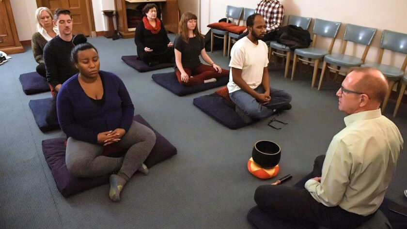 John Corbaley leads a group in one of two daily Serenity Pause meditation sessions at the Unity Temple in Kansas City, Mo.