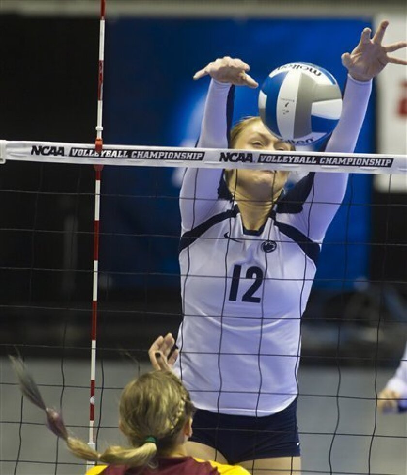 Penn State's Micha Hancock (12) blocks a shot by Minnesota's Katherine Harms during an NCAA women's college volleyball regional final, Friday, Dec. 7, 2012, in West Lafayette, Ind.Penn State won 3-1. (AP Photo/Journal & Courier, Michael Heinz) MANDATORY CREDIT. NO SALES.