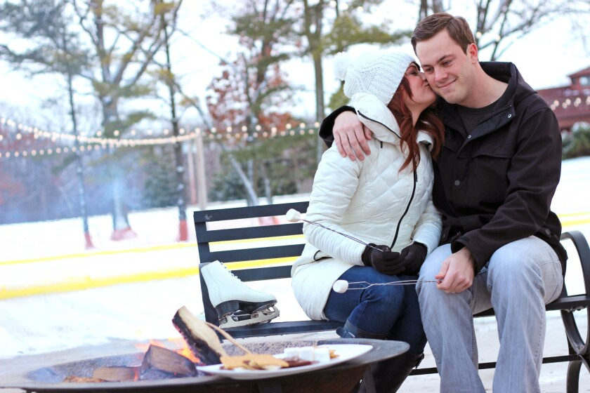 Couples can go ice skating and make s'mores by the fire pit at an outdoor ice rink at The Ridge Hotel in Lake Geneva, Wis.