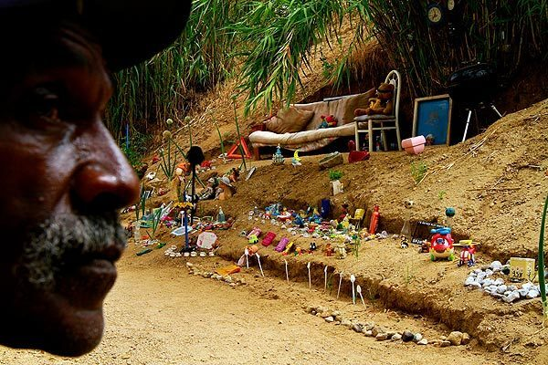 Charles Ray Walker, who began collecting discarded toys in 1993, said Christmas is the best time to find them because people throw away old toys to make room for the new. He uses these toys to decorate his garden, pathways and stairs that he has carved in the bamboo clearing.