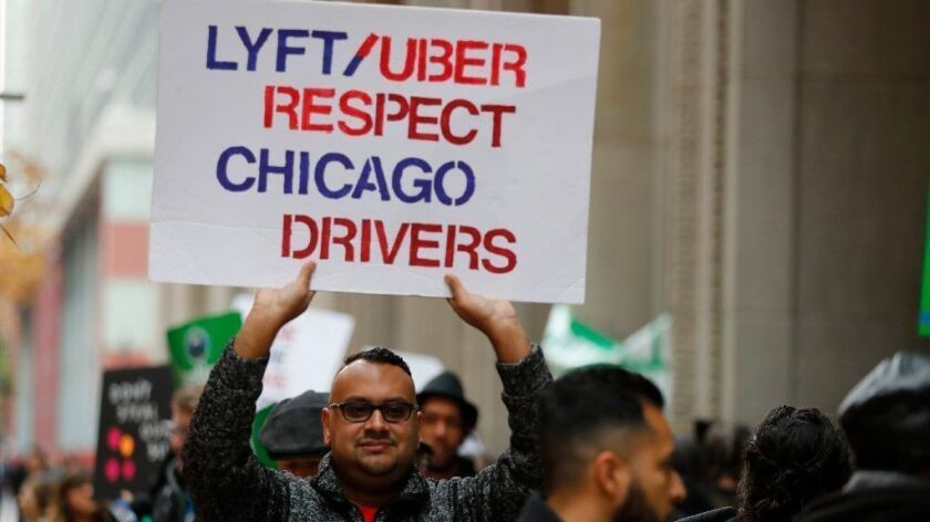 Chicago Rideshare Advocates and Cab Drivers United conduct a driver rally Oct. 31, 2018, outside City Hall before the Chicago City Council budget meeting.