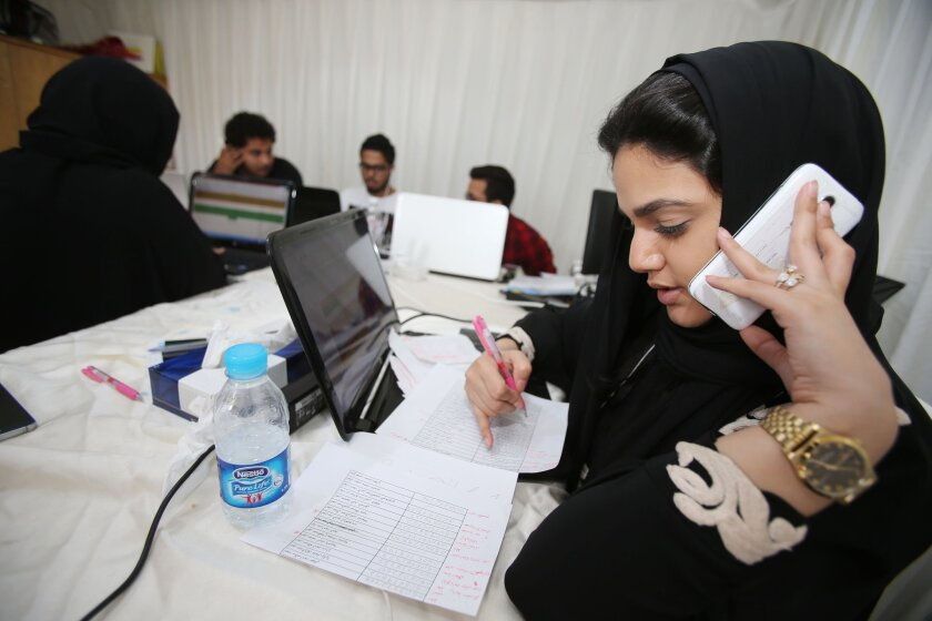 Communication staff members for the campaign of a female candidate in the Saudi municipal elections contact voters in Jidda.