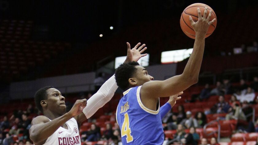 UCLA guard Jaylen Hands (4) shoots in front of Washington State guard Viont'e Daniels (24) during th