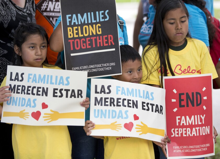 Children hold signs during a demonstration in front of the Immigration and Customs Enforcement offices June 1, 2018, in Miramar, Fla. The Trump administration's move to separate immigrant parents from their children on the U.S.-Mexico border has turned into a full-blown crisis in recent weeks.