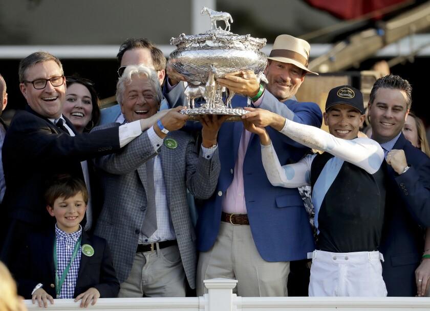 From left, Brian Spearman, Robert LaPenta, George Isaacs, jockey Jose Ortiz and Aron Wellman celebrate after 2017 Belmont.