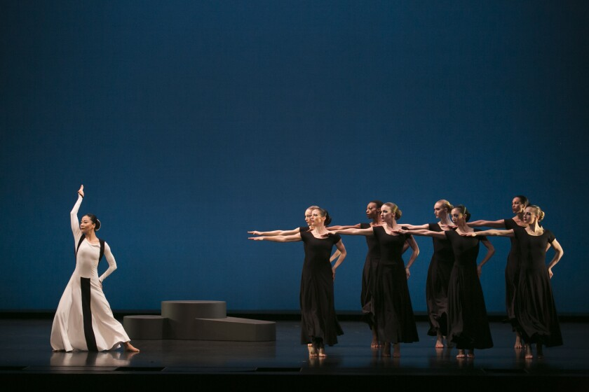 "Xin Ying (left) and the Martha Graham Dance Company in ""Chronicle."""