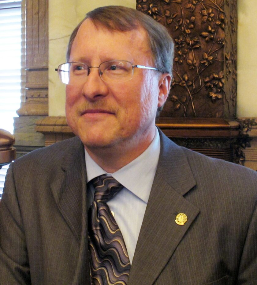 File-This May 9, 2011, file photo shows Kansas House Pensions and Benefits Committee Chairman Mitch Holmes, a St. John Republican, at the Statehouse in Topeka, Kan. A dress code imposed by Holmes, a Kansas Senate committee chairman, prohibits women testifying on bills from wearing low-cut necklines and miniskirts is drawing bipartisan ridicule from female legislators. Holmes' 11-point code of conduct does not include any restrictions on men, who he said needed no instruction on how to look professional, The Topeka Capital-Journal reported. (AP Photo/John Hanna,File)