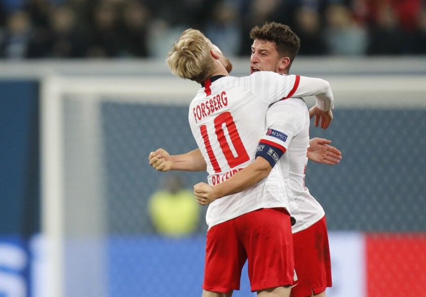 Leipzig's Diego Demme, right, celebrates with teammate Leipzig's Emil Forsberg after scoring the opening goal during the Champions League group G soccer match between Zenit St. Petersburg and RB Leipzig at the Saint Petersburg stadium in St.Petersburg, Russia, Tuesday, Nov. 5, 2019. (AP Photo/Dmitri Lovetsky)