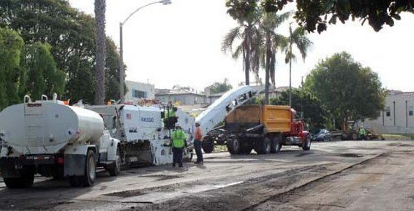 Crews work on repaving Pearl Street on Nov. 21. Photo: Dave Schwab