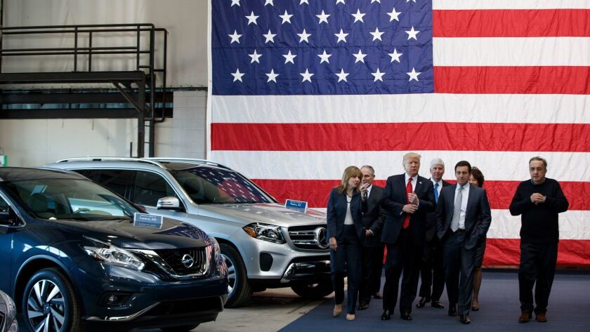 President Trump tours a Detroit-area exhibition on March 15 flanked, from left, by GM CEO Mary Barra, EPA Administrator Scott Pruitt, Michigan Gov. Rick Snyder, Ford CEO Mark Fields, Transportation Secretary Elaine Chao and Fiat Chrysler CEO Sergio Marchionne.