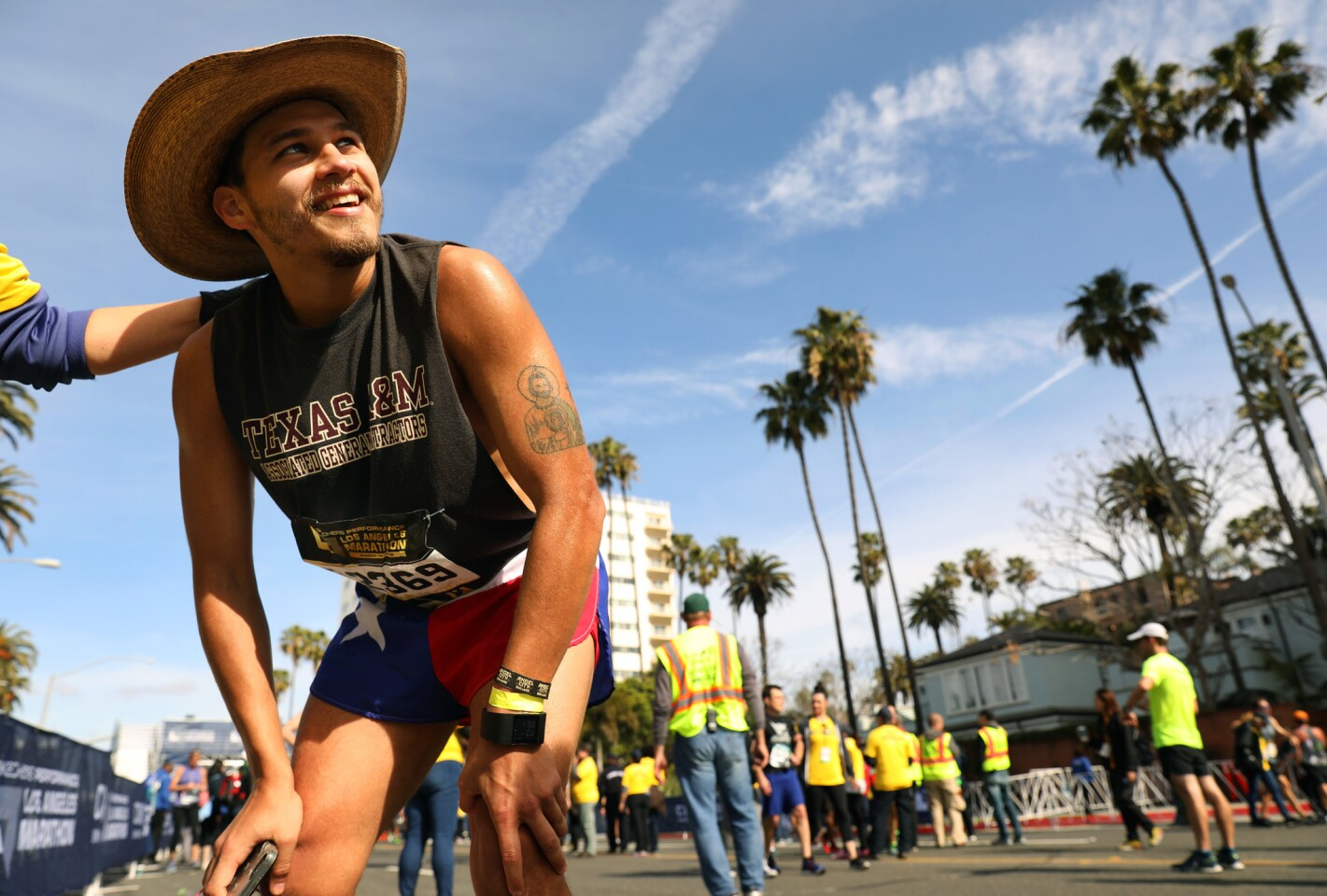 Race participant Jose Lara of Houston, Texas, catches his breath after finishing the L.A. Marathon on Sunday.