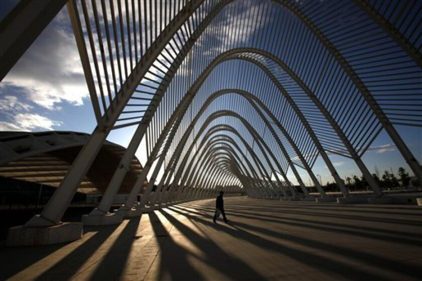 In this photo taken on May 17, 2010, a man walks inside the modern Agora walkway at the Athens main Olympic complex. Olympic officials deny that massive spending for the 2004 Games in Athens contributed to the country's financial crisis. (AP Photo/Petros Giannakouris)