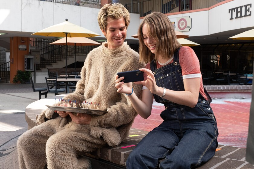 """Andrew Garfield and Maya Hawke share a laugh in a scene from """"Mainstream."""""""