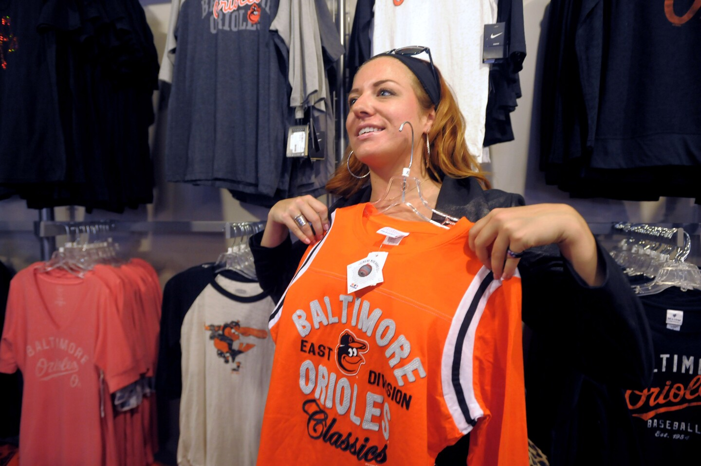 Kristen Hildebrand holds up a jersey for her mother's approval in the Majestic Team Store, in the warehouse at Camden Yards. With the Orioles possible headed for the play-offs the sales of team merchandise has been skyrocketing.
