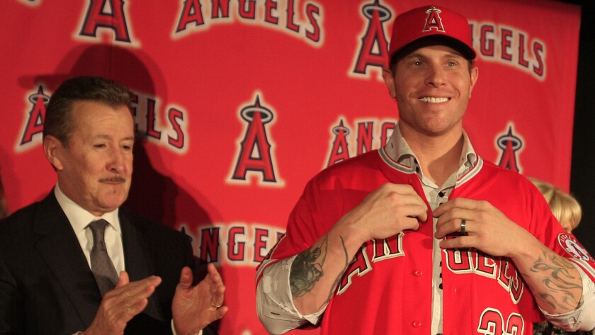 With the Angels still paying the contract of Josh Hamilton, right, owner Arte Moreno, left, is reluctant to go after a big-name bat.