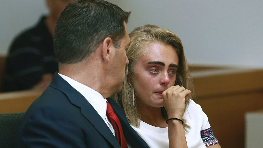 FILE - In a Thursday, Aug. 3, 2017 file photo, Michelle Carter awaits her sentencing in a courtroom