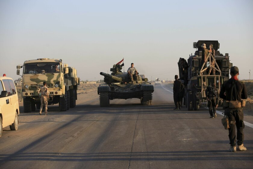 Iraqi military forces prepare for an offensive into Fallujah to retake the city from Islamic State militants in Iraq, Monday, May 30, 2016. An Iraqi special forces commander says Iraqi forces have started pushing into Fallujah as part of the ongoing operation to oust Islamic State militants from th